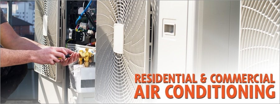 Photo for Shogun Services's Residential and Commercial Air Conditioning Repair and Installation. Man provides work on an air conditioner