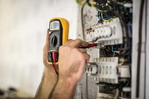 Electrician providing service with a meter. Shogun Services is a residential electrician